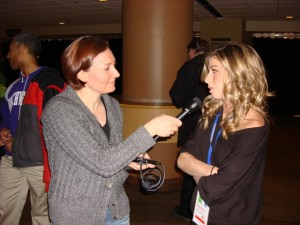 Allison Manley interviewing pairs skater Brooke Castille in a photo for the Manleywoman Skatecast, a figure skating podcast