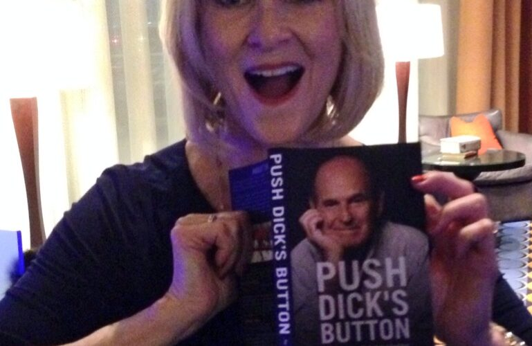 JoJo Starbuck holding up a copy of Dick Button's book in a photo for the manleywoman skatecast, a figure skating podcast