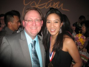Michelle Kwan with a fan in a photo for the Manleywoman Skatecast, a figure skating podcast